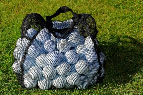 Picture of a sack of golf balls on grass